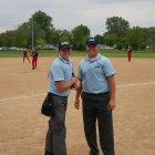 umpire crew takes a pose